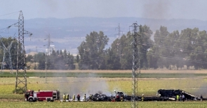 Firefighters at the scene of the crash (Photo: EPA)