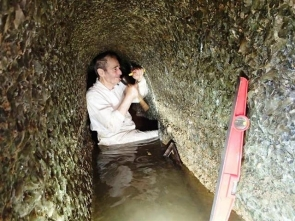 Professor Calaforra installing a water measuring device in the spring