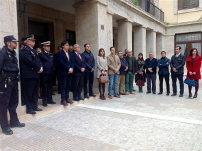 Officials hold a minute's silence in memory of the victims outside a government building in Almería city
