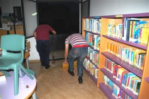 Library staff mopping up during last week's torrential rain