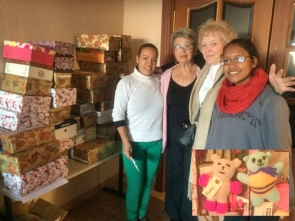 Margaret Chadwick and Di Mather (centre) with the two young ladies who helped to get the boxes together (inset: two of the teddies)