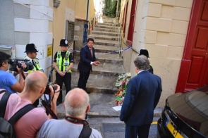 Gibraltar chief minister Fabian Picardo laying a wreath outside the site of the crime last week