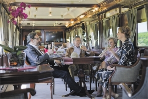 Al Andalus passengers enjoying the cosseted comfort of yester year in carriages that were once used by the British royal family to travel through France