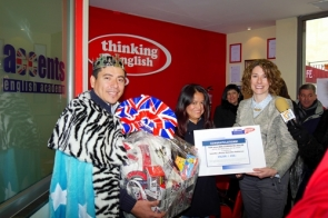 Accents English Academy owner Debbie Shaw (right) with draw winner Spencer González and his wife Gaby