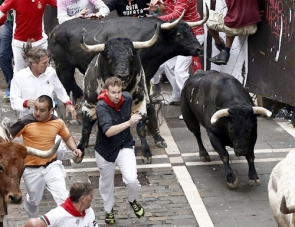 Runners during Monday's bull run at the Pamplona Festival
