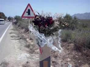 Flowers mark the scene of the accident