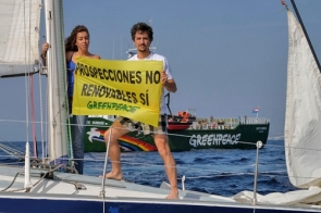 Protesters and Greenpeace's Arctic Sunrise during Sunday's demonstration